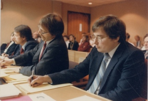 """Mark Hofmann sits with his lawyers during the trial."" Special Collections Dept., J. Willard Marriott Library, University of Utah."